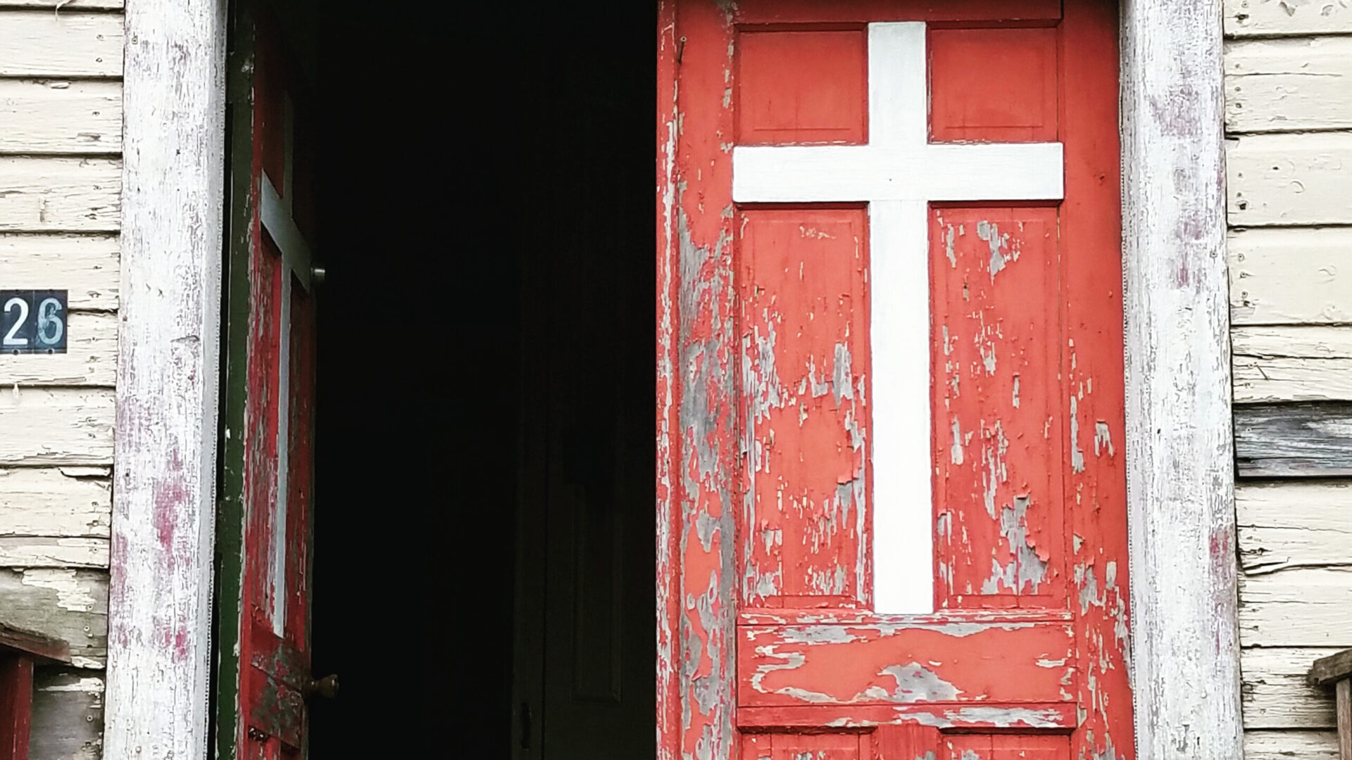 red door with cross