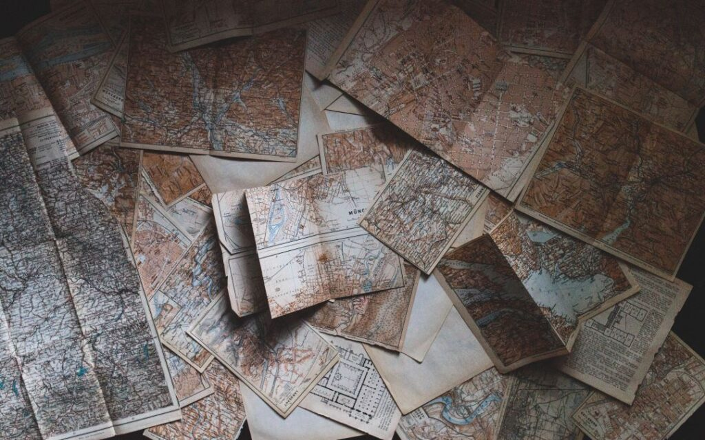 artistic stack of maps