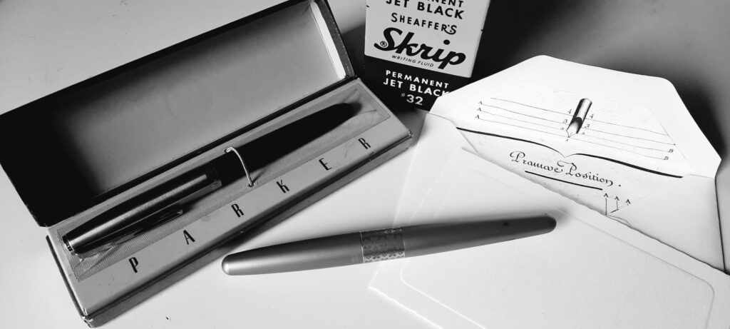 fountain pen and letter